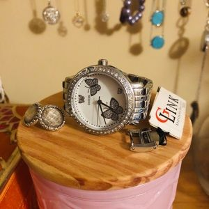 GUESS ladies watch, butterfly design.